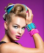 Fashion portrait of young caucasian model with bright makeup. Beautiful woman with creative hairstyl poster