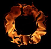 fire - a ring created by the flame and large burning flames on a black background poster