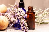 Lavender Mortar And Pestle And Bottles Of Essential Oils For Aromatherapy poster