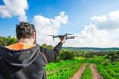 Man Holds Small Compact Drone In His Hands. Pilot Launches Quadrupter From His Palm. Drone Ready To  poster