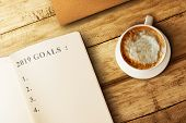 List For 2019 Goals In The Book With Coffee On Wooden Table. Goals Of 2019. Happy New Year 2019 poster