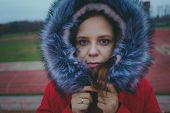 Girl Posing On The Street, A Student In Street Clothes In The Winter. Street Style. Emotional Portra poster