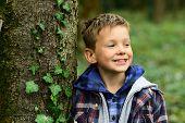Its Just A Fun. Little Boy Have Fun Outdoor. Little Boy Enjoy Fun Time In Park. Enjoying The Little  poster