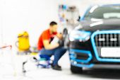 Blurred Abstract Image Of Man Worker With Car In Body Shop. Blur Car Auto Service. Car Bokeh. Blurre poster