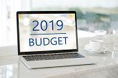 Laptop Computer With 2019 Budget On Screen Background, Digital Marketing, Business And Technology Co poster