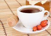 stock photo of bag-of-dog-food  - berry dog tea and honey on wood - JPG