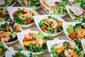 Snack Of Shrimp, Avocado And Greens On Plates For Guests Of The Event. Catering And Snacks For Guest poster