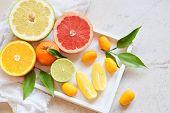 Set Of Citrus On Light Background: Orange, Mandarin, Lemon, Grapefruit, Lime, Kumquat, Tangerine. Fr poster