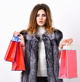 Woman Shopping Luxury Boutique. Lady Hold Shopping Bags In Hands. Shopping Concept. Fashionista Buy  poster