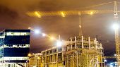 Lots Of Tower Cranes Build Large Residential Buildings At Night. Buildings Under Construction, Crane poster