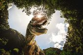 Dinosaur , T-rex   With Tree Branches Against On The Nature . poster