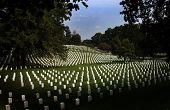 stock photo of arlington cemetery  - Hundreds of headstones are visible in the light - JPG
