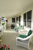 picture of screen-porch  - quaint covered porch with wicker chairs and rocking chairs - JPG