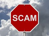 image of unsafe  - An American road stop sign with word fraud with clouds and sky Help stop Scam - JPG