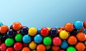 stock photo of gumballs  - many colored gumballs isolated on green background - JPG