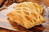 picture of beef wellington  - Fresh baked Beef Wellington on a cutting board - JPG