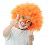 stock photo of circus clown  - Portrait of happy funny clown kid - JPG