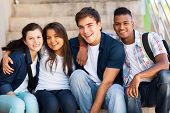 stock photo of classmates  - group of cheerful high school students friends - JPG