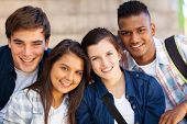 image of cheers  - group of happy teen high school students outdoors - JPG