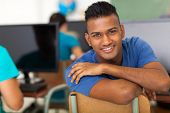 pic of indian blue  - handsome male indian high school student looking back in classroom - JPG