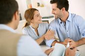 stock photo of draft  - Young couple meeting construction planner - JPG