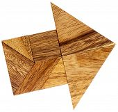 picture of tangram  - abstract picture of an arrow built from seven tangram wooden pieces - JPG