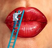 stock photo of reconstruction  - Plastic surgery and cosmetic improvement medical health care concept with a surgeon doctor climbing a ladder ti fix and restore human lips as an idea of fighting the aging process to retain beauty - JPG