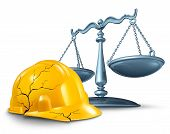 stock photo of justice  - Construction injury law and work accident and health hazards on the job as a broken cracked yellow hardhat helmet and a scale of justice in a legal concept of worker compensation issues on a white background - JPG