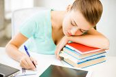 picture of boredom  - picture of tired student sleeping on stock of books - JPG