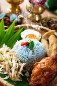 Traditional Malaysian food. Nasi kerabu is a type of nasi ulam, popular Malay rice dish. Blue color