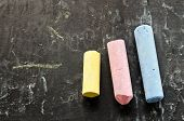 Colorful Chalks On Blackboard