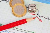 Downtrend Financial Chart, Red Pencil, Red Arrow, Dices Cube With The Word Stop And One-euro Coins.