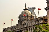 stock photo of hsbc  - HSBC Building now used by a Chinese Bank The Bund Old Part Shanghai China with Flags - JPG