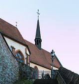 stock photo of carmelite  - Carmelite Monastery Church of ancient town village of Hirschhorn in Hesse district of Germany on banks of Neckar river - JPG
