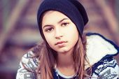 image of lonely woman  - face of beauty teenage girl in hat outdoors - JPG