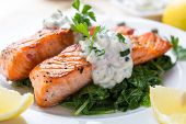 stock photo of bbq food  - Grilled Salmon with Spinach - JPG