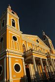 image of rebuilt  - The Cathedral of Granada is a bright yellow neoclassical church originally built in 1583 - JPG