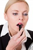 Attractive Businesswoman Applying Lipstick