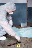 image of gruesome  - Forensic expert dusting for fingerprints on knife  - JPG