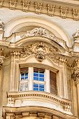 stock photo of stone sculpture  - stone facade on classical building with ornaments and sculptures - JPG