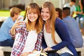 stock photo of playground school  - Female High School Students Taking Selfie On Campus - JPG