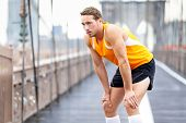 pic of brooklyn bridge  - Running man resting after run in New York City - JPG