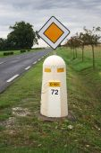picture of liberte  - French road sign and bollard with road and trees in background - JPG