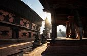 stock photo of nepali  - Palace and Temples on Durbar square in the morning in Bhaktapur Kathmandu valley Nepal - JPG