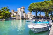stock photo of lagos  - medieval castle Scaliger in old town Sirmione on lake Lago di Ga - JPG