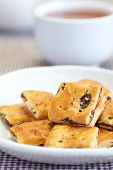 image of baked raisin cookies  - sweet Oatmeal raisin cookies and cup of tea - JPG