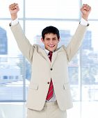 Cheerful Businessman Punching The Air In Celebration