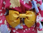 stock photo of geisha  - geisha in pink kimono with yellow munsuko - JPG