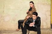 stock photo of cold-shoulder  - Young fashion woman sitting behind her lover - JPG