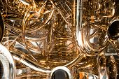 pic of trombone  - Twisted gold pipes from trombone create a wonderful background - JPG